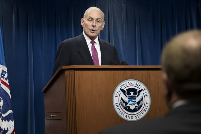Secretary of Homeland Security John F. Kelly responds to questions from the news media about the Trump administration's controversial immigration suspension during a press conference at the Customs Border Protection Department in Washington, D.C., on Tuesday. The department said nearly 900 refugees were give waivers and will enter the United States this week. Photo by Shawn Thew/EPA