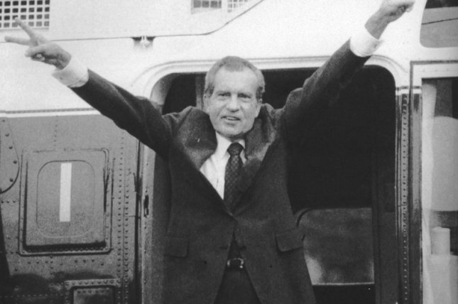 President Richard Nixon waves goodbye before boarding Marine One on the South Lawn of the White House following his resignation on August 8, 1974 -- 26 months after the break-in at the Watergate complex began to envelop his presidency. File Photo by Ron Bennett/UPI
