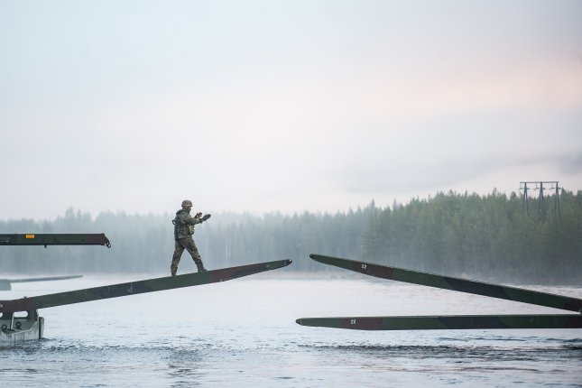 German soldiers from 2 Company Multinational Engineer Battalion of NATO's Very High Readiness Joint Task Force, man an M3 Amphibious Rig while conducting river crossing training duting exercise Trident Juncture at Camp Røedsmoen in Rena, Norway on Tuesday. Photo by Sgt Marc-André Gaudreault/U.S. Army
