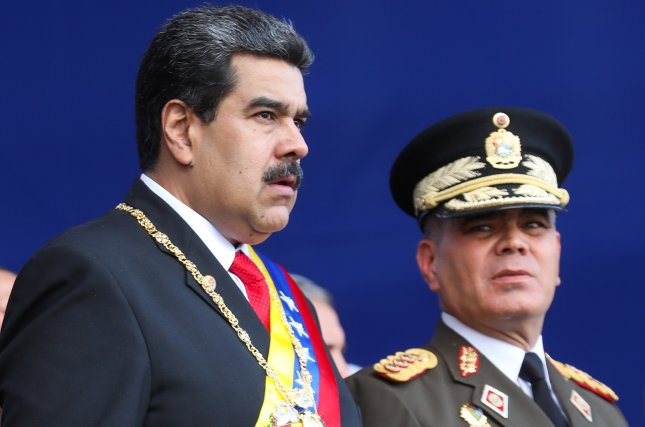 Venezuelan President Nicolas Maduro (L) and Defense Minister Vladimir Padrino (R) during a ceremony with the Armed Forces, that endorsed his second term in office which started Thursday amid opposition. Photo by Cristian Hernandez/EPA-EFE