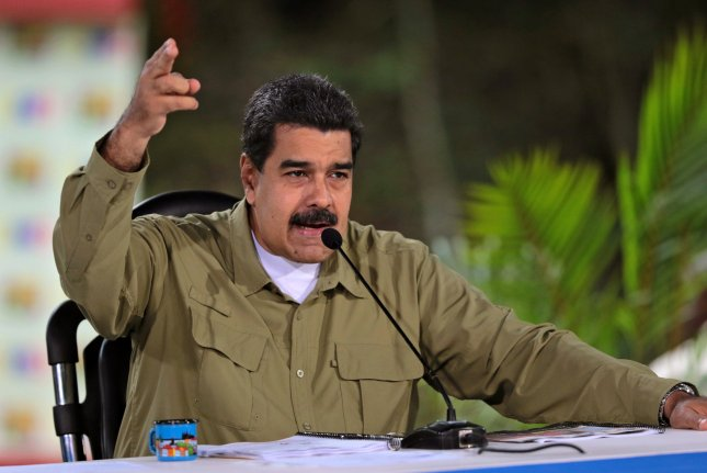 A handout photo made available by Miraflores Palace Press Office in August 2017 shows Venezuelan President Nicolas Maduro as he speaks during a government act at Vinicio Adames Park, in Miranda, Venezuela. Maduro is expected to win another six-year term in elections Sunday. File Photo by EPA/Miraflores Palace Press Office Handout