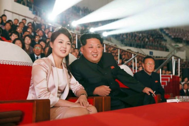 North Korean first lady Ri Sol Ju (L) was depicted on the cover of a pornographic DVD that was included in defector balloon launches in the South, according to a South Korean press report. File Photo by Rodong Sinmun/EPA
