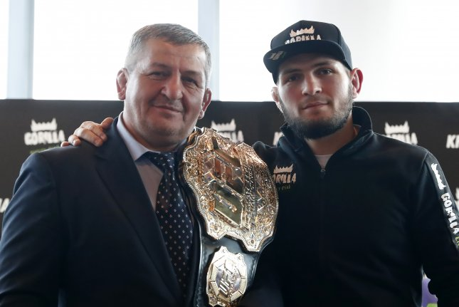 The fight against Justin Gaethje was Khabib Nurmagomedov's (R) first bout since his father and head coach, Abdulmanap (L), died in July from COVID-19 complications. File Photo by Maxim Shipenkov/EPA-EFE