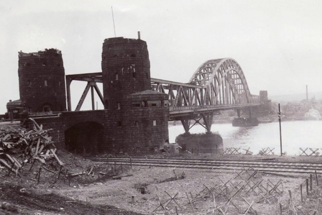 The Ludendorff Bridge over the Rhine between Erpel (foreground, east side) and Remagen (background, west side) after it was captured by U.S. troops on March 7, 1945. File Photo courtesy of the U.S. Signal Corps