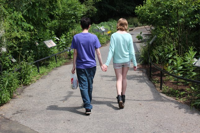A couple holds hands and walks a the National Zoo in Washington, DC. (UPI/Billie Jean Shaw)