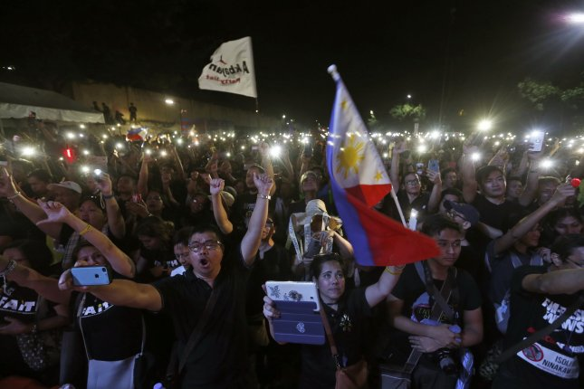 Thousands of people gathered in the Philippines capital city of Manila to support and protest current President Rodrigo Duterte on the 31st anniversary of the People Power Revolution that overthrew former dictator Ferdinand Marcos.  Photo by Rolex Dela Pena/EPA