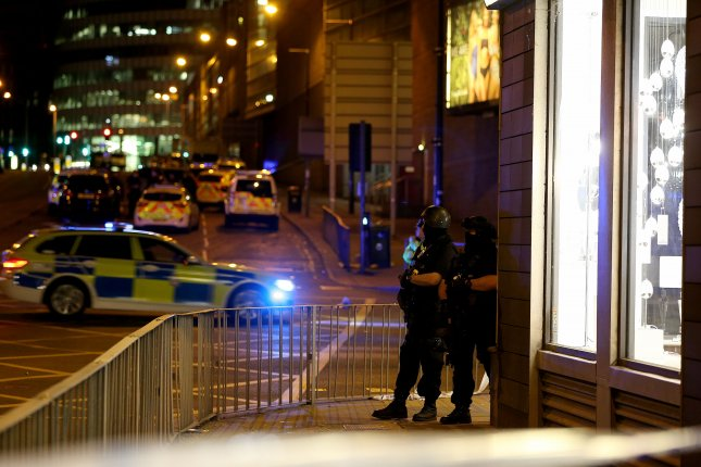Armed officers patrol near the Manchester Arena Monday night following reports of an explosion during an Ariana Grande concert. Authorities said at least 22 people were killed and dozens more were injured. Photo by Nigel Roddis/EPA