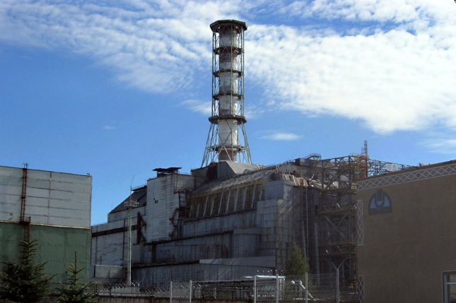 Researchers say they have linked a cluster of cases of a rare form of cancer in New York City to the 1986 Chernobyl nuclear plant disaster. Pictured, the Chernobyl reactor #4 building in 2006, including the later-built sarcophagus and elements of the maximum-security perimeter. Photo by Carl Montgomery/Wikimedia Commons