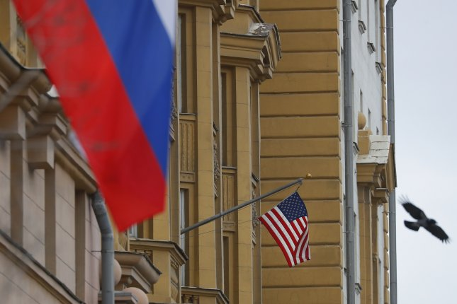 The American flag is seen at the U.S. Embassy in Moscow, Russia.Officials from Washington and Moscow are meeting in Switzerland Wednesday to discuss nuclear stability. File Photo by Sergei Ilnitsky/EPA-EFE