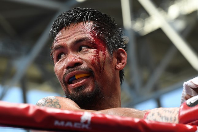 Manny Pacquiao of the Philippines reacts against Jeff Horn of Australia (not pictured) during their WBO World Welterweight title boxing match Sunday at Suncorp Stadium in Brisbane, Queensland, Australia. Photo by Dave Hunt/EPA