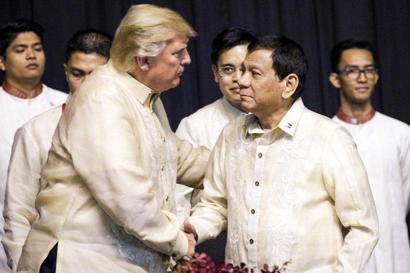 U.S. President Donald Trump shakes hands with Philippines President Rodrigo Duterte in Manila, Philippines, on Monday at the start of the ASEAN summit. Photo by Athit Perawongmetha/EPA