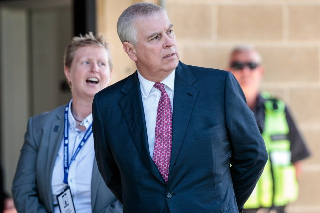 Britain's Prince Andrew, duke of York (C) is met by the provost of Murdoch University Professor Romy Lawson upon on his arrival at the university in Perth, Western Australia on October 2. File Photo by Richard Wainwright/EPA-EFE