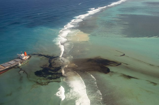 The oil leak from the MV Wakashio leaves streaks of black across the previously pristine turquoise waters of the island nation. Photo courtesy of the French General Staff Army/EPA-EFE
