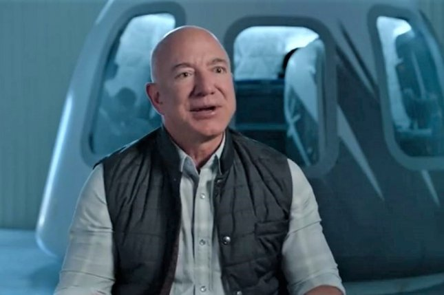 Amazon founder Jeff Bezos is pictured in front of his company Blue Origin's New Shepard capsule. Photo courtesy of Blue Origin