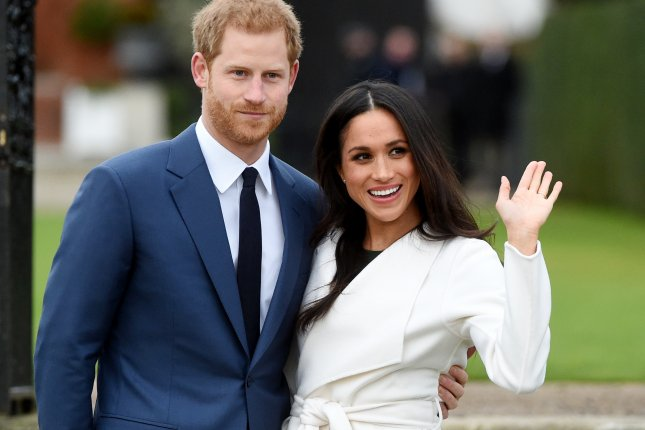 Britain's Prince Harry poses with Meghan Markle on Monday after announcing their engagement in the Sunken Garden in Kensington Palace in London. Photo by Facundo Arrizabalaga/EPA-EFE