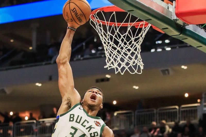 Milwaukee Bucks forward Giannis Antetokounmpo of Greece (L) dunks against the Sacramento Kings. Photo by Tannen Maury/EPA-EFE