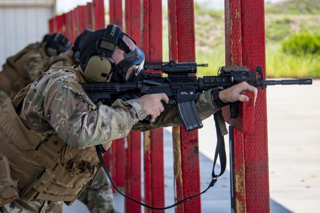 An Airman assigned to the 355th Security Forces Squadron fires an M4 carbine during a new Security Forces Qualification Course at Davis-Monthan Air Force Base, Ariz., on August 11, 2021. Photo by Senior Airman Alex Miller/U.S. Air Force