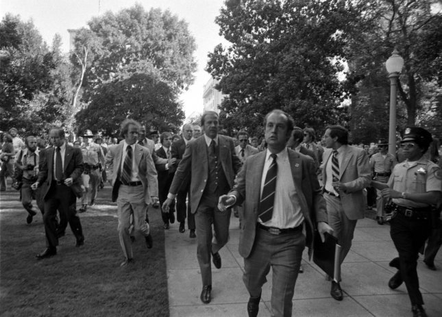 Secret Service agents rush President Gerald R. Ford towards the California State Capitol following an attempt on the President's life by Lynette Squeaky Fromme - a disciple of Charles Manson - on September 5, 1975, in Sacramento, Calif. Photo courtesy Gerald R. Ford Library