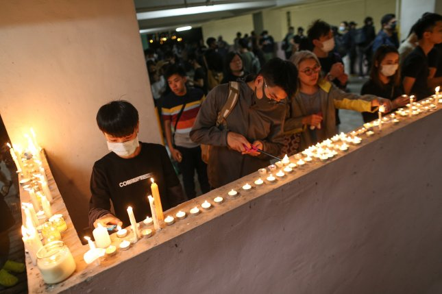 Protesters and students gather for a vigil in Hong Kong, China, on Friday. Photo by Jerome Favre/EPA-EFE