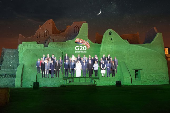 A handout photo made available by G20 Riyadh Summit shows a virtual family photo of G20 leaders projected on the walls of At-Turaif district in Ad-Diriyah, Riyadh, Saudi Arabia. Photo courtesy of the G20 Riyadh summit