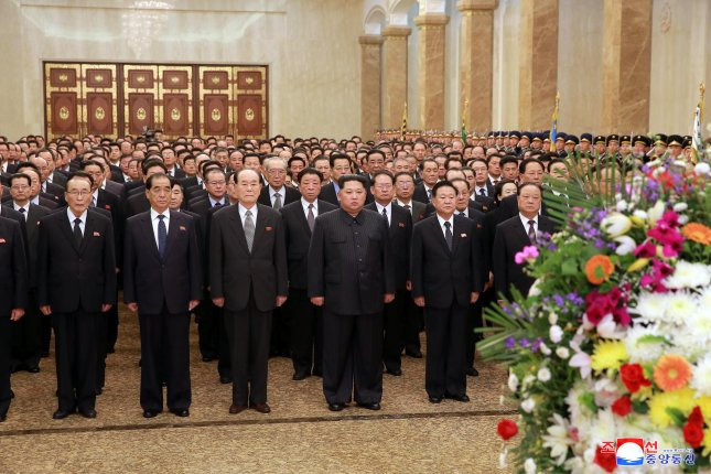 North Korean leader Kim Jong Un (C) visits the Kumsusan Palace of the Sun to pay tribute to President Kim Il Sung and leader Kim Jong Il, on the birth anniversary of Kim Il Sung on (known in North Korea as 'The Day of the Sun') in Pyongyang, North Korea, 15 April 2018 (issued 16 April 2018). Photo by KCNA.