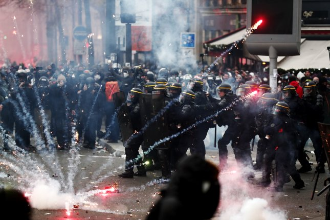 French riot police clash Thursday with protesters during a demonstration against proposed pension reforms in Paris, France. Photo by Ian Langsdon/EPA-EFE