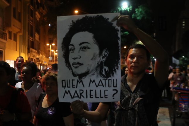 A man holds a poster with a drawing representing the Brazilian councilor Marielle Franco in which it reads Who killed Marielle? during a symbolic protest that rejects her murder in Rio de Janeiro, Brazil on March 20, 2018. Data released by the Brazilian Public Security Forum Thursday showed 63,880 people were murdered in 2017 including 4,539 murders of women. Photo by Marcelo Sayao/EPA