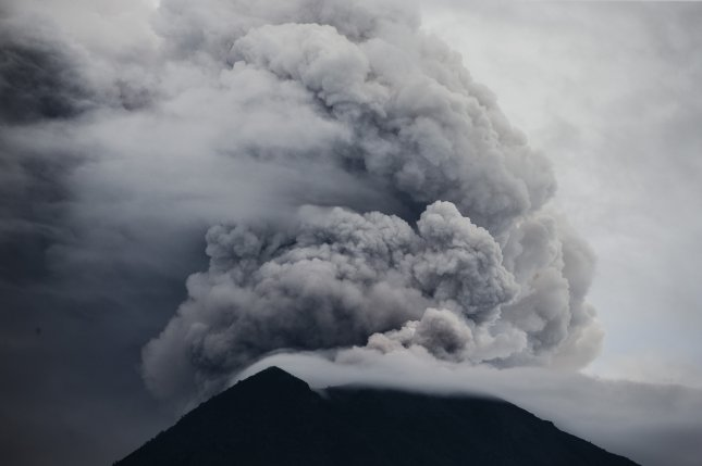Mount Agung is seen from Karangasem, Bali, Indonesia, Wednesday as it emanates ash. The island's airport reopened Wednesday after remaining closed for three days. Photo by Made Nagi/EPA-EFE