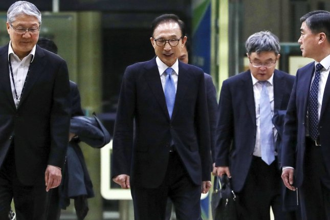 Prosecutors question another ex-South Korean leader