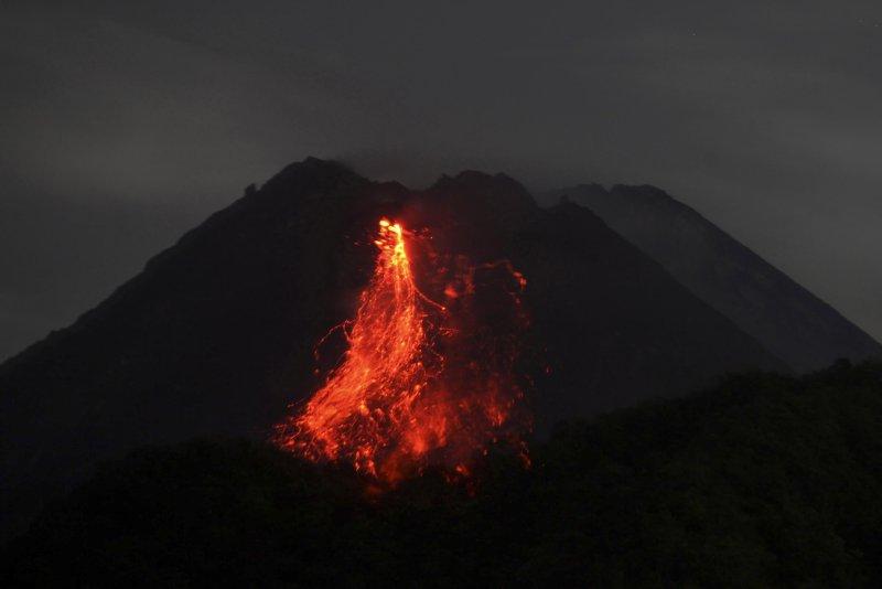 Mount Merapi volcano spews lava during an eruption, as seen from Sleman, Yogyakarta, Indonesia, on Jan. 17, 2021. File Photo by Boy Triharjanto/EPA-EFE