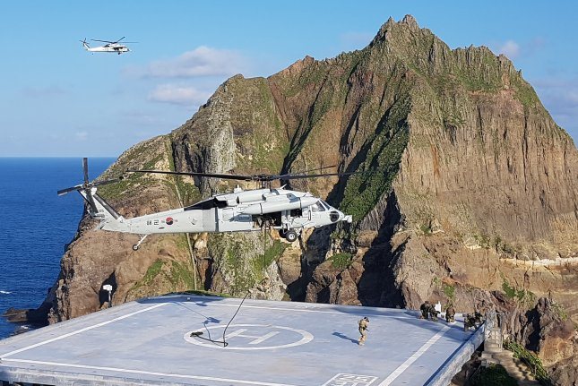 South Korea's military flew fighter jets over the disputed Dokdo Islets (pictured) on Tuesday. File Photo by Yonhap