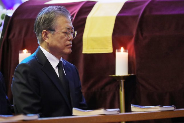 President Moon Jae-in attends a funeral Mass for his mother, Kang Han-ok, at Namcheon Catholic Cathedral in the southeastern city of Busan on Thursday. Photo by Yonahp