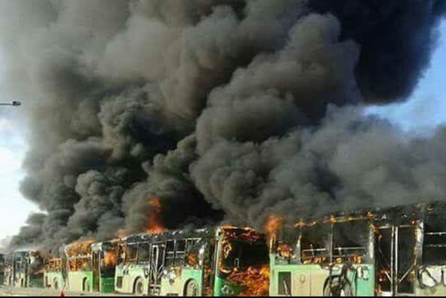 Fire engulfs green government buses -- which are used to evacuate refugees from areas of fighting -- in Syria's northwest Idlib province. File Photo by SANA/EPA-EFE