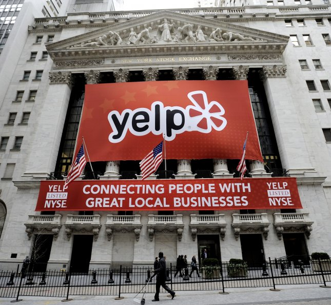 A view of a Yelp sign on the front of the New York Stock Exchange following the company's initial public offering in New York City on March 2, 2012. On Monday, the California Supreme Court ruled the company was not responsible for defamatory reviews and did not have to remove them. File Photo by Justin Lane/EPA