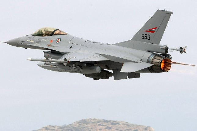 A Norwegian F-16 jet fighter takes off on a mission to Libya from the Souda military base on Crete Island, Greece, in 2011. File Photo by Stefanos Rapanis/EPA