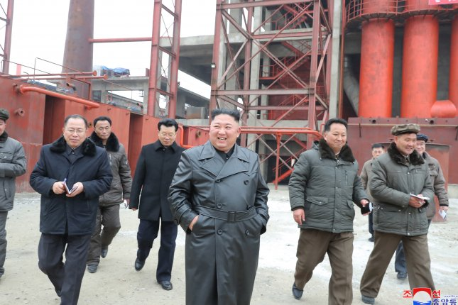 Kim Jong Un (C) has been seen in a black leather trench coat in December and January. North Korea passed a leather trade law, according to state media on Thursday. File Photo by KCNA/EPA-EFE