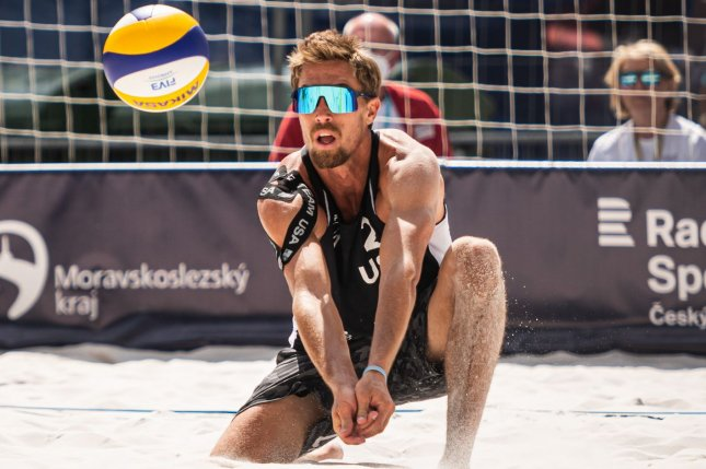 Team USA beach volleyball player Taylor Crabb, who is vaccinated, withdrew from the 2020 Summer Games due to a positive COVID-19 test. Photo by the International Volleyball Federation