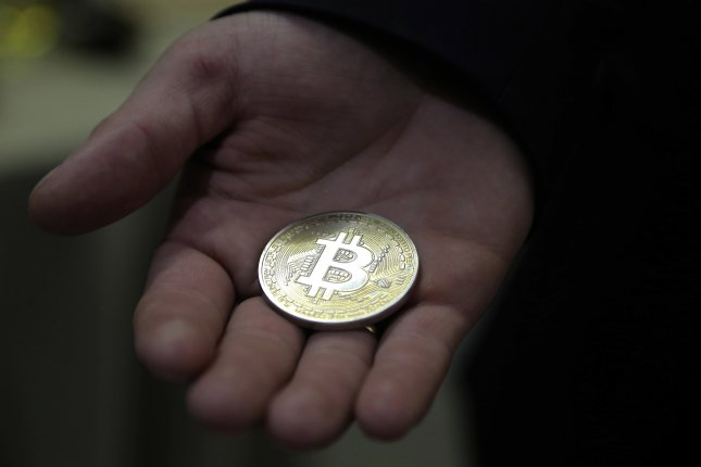 The digital currency Bitcoin, shown here represented by a souvenir coin, surged this week past $19,800, soaring past its three-year high in 2017. File Photo by Maxim Shipenkov/EPA-EFE