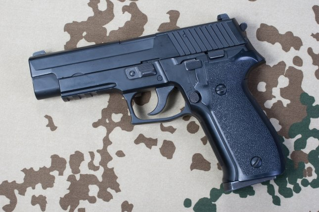 A pistol, such as this Sig Sauer hand gun, may have been stolen from a federal agent and used in a July 1 shooting that left Kathryn Steinle, 32, dead on a San Francisco pier. Photo by Militarist/Shutterstock