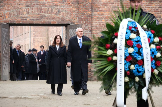 U.S. Vice President Mike Pence with his wife Karen Pence visit the Death Wall during their visit Friday to the former Nazi-German death camp of Auschwitz, in Oswiecim, southern Poland. Photo by Andrzej Grygiel/EPA-EFE