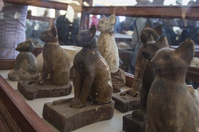 Statues of cats are displayed after they were excavated in Saqqara, south of Cairo, Egypt, Saturday. According to the Egyptian Ministry of Antiquities, archaeologists found the remains of mummified cats, including five large animals believed to be lion cubs, at Saqqara Necropolis. The archaeological team also found a number of mummified animal and birds and dozens of statues in different sizes and shapes. Photo by Mohamed Hossam/EPA-EFE
