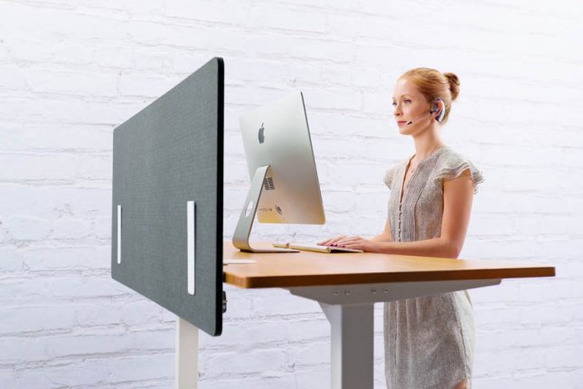 Although health concerns about sitting too much are real, new research suggests that standing desks are not necessarily better for health -- they can affect blood flow, and discomfort from standing can affect work flow -- and researchers say people may be better if they just take a walk a few times a day. Photo by Uplift Desk