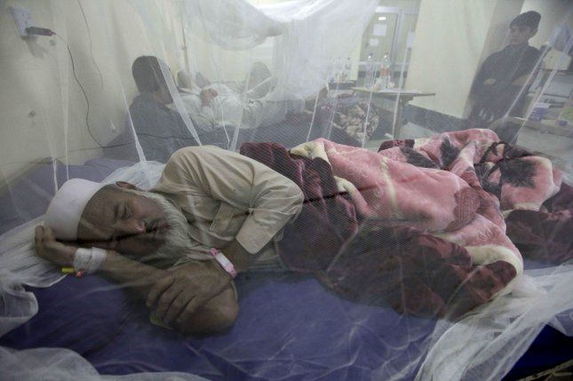 Patients with dengue fever receive medical treatment at an isolation ward of a local hospital in Peshawar, Pakistan, on November 6, 2017. The World Health Organization now is recommending that a vaccine against dengue should only be used on people who have previously been infected with the disease. Photo by Arshad Arbab/EPA