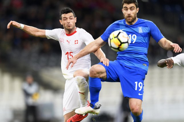 Switzerland's midfielder Blerim Dzemaili (L) in action against Greece's defender Sokratis Papastathopoulos during the International Friendly soccer match between Greece and Switzerland on March 23 at the Olympic stadium in Athens, Greece. Photo by Laurent Gillieron/EPA-EFE