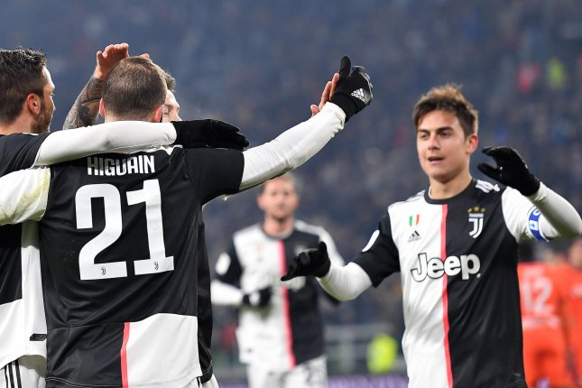 Paulo Dybala (R) had two goals and an assist, while Gonzalo Higuain (21) had a goal and an assist in Juventus' win against Udinese Wednesday in Turin, Italy. Photo by Alessandro Di Marco/EPA-EFE