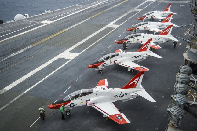 Investigators say the T-45C Goshawk that crashed on Oct. 1 has again raised issues about the training aircraft, which were grounded briefly in April for an investigation into concerns about the plane's oxygen system. Investigators say the problematic oxygen system was installed on the T-45C that crashed most recently, though they have not blamed it for the crash. Pictured, T-45C Goshawks from Training Air Wing One 1 on the flight deck of the aircraft carrier USS George Washington. U.S. Navy photo by Petty Officer 2nd Class Bryan Mai