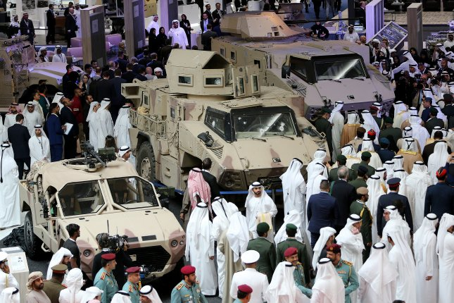 Visitors view armored vehicles during International Defense Exhibition and Conference on Tuesday in Abu Dhabi, United Arab Emirates. Photo by EPA