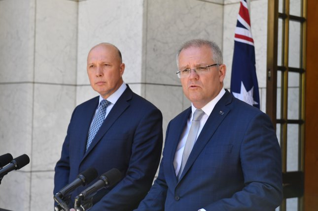 Minister for Home Affairs Peter Dutton (L) and Prime Minister Scott Morrison (R) speak during a press conference at Parliament House in Canberra, Australia, on Wednesday after the repeal of a law allowing asylum seekers to be sent to Australia for medical treatment. Photo by Mick Tsikas/EPA-EFE