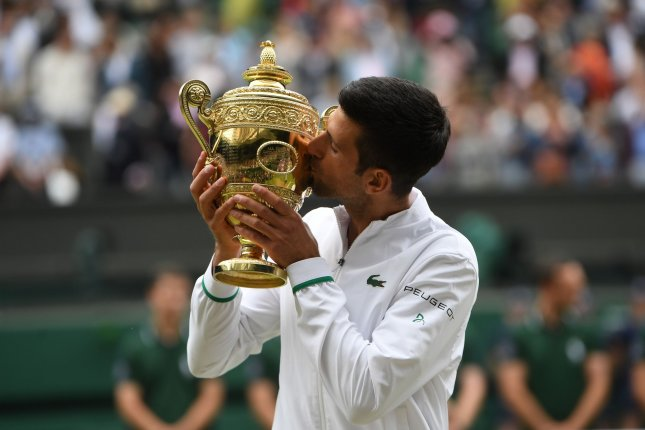 Novak Djokovic of Serbia (pictured) kisses the trophy after winning the men's final against Matteo Berrettini of Italy at the Wimbledon Championships on Sunday in London. Photo by Neil Hall/EPA-EFE