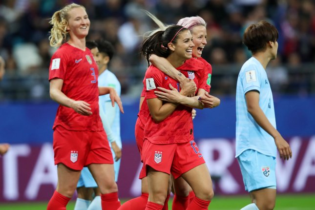Alex Morgan (C) of USA celebrates a goal with teammates against Thailand during the 2019 FIFA Women's World Cup preliminary round on Tuesday in Reims, France. Photo by Tolga Bozoglu/EPA-EFE